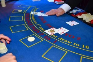 How is blackjack played in the casino?